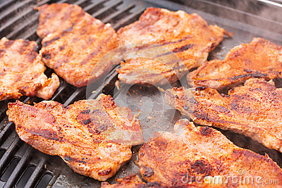 Pork meat on barbecue