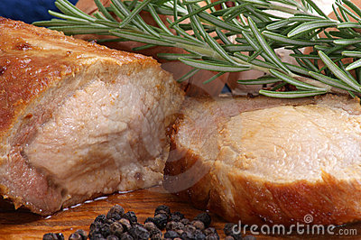 pork with rosemary on a wooden board