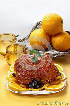 Pork served on oranges.