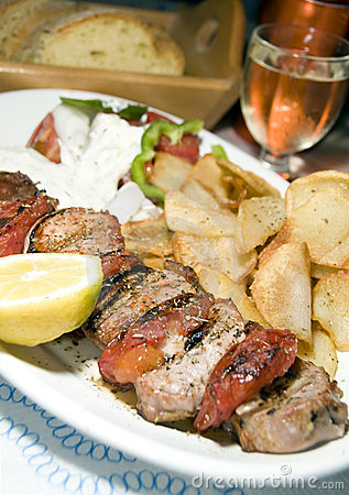 Pork souvlaki with tzatiki house wine bread
