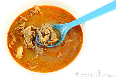 Pork spicy curry with blue spoon