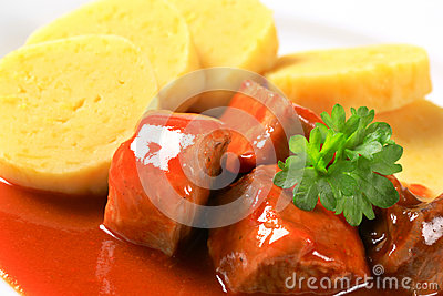 Pork in tomato sauce with potato dumplings