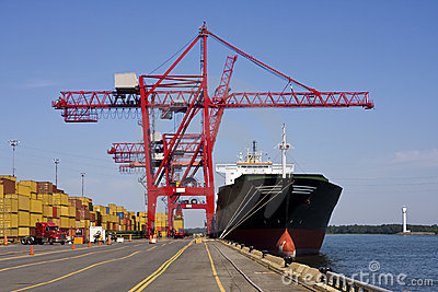Port Container Cranes unloading a Ship