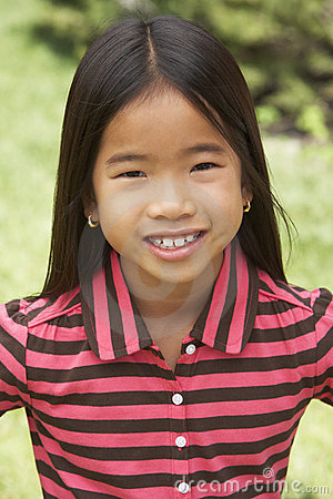 Portait Of Smiling Young Girl Outdoors