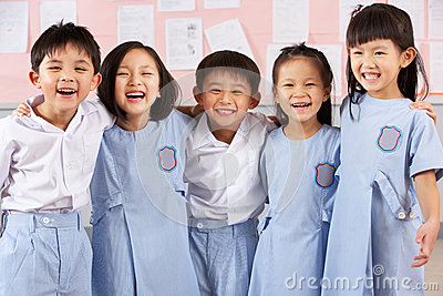 Portait Of Students In Chinese School Classroom