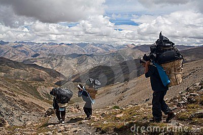 Porters with heavy load in the Himalaya Editorial Stock Image