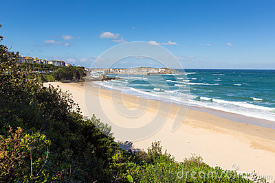 Porthminster beach St Ives Cornwall England with white waves and blue sea and sky