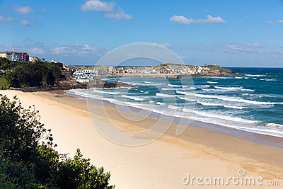 Porthminster beach and St Ives Cornwall England with white waves and blue sea and sky