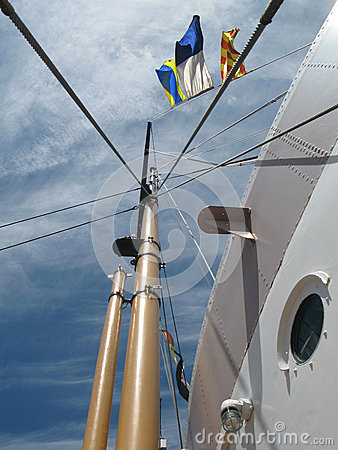 Porthole, flags and rivets