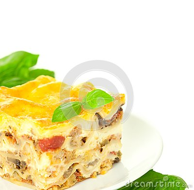 Portion of Classic Lasagna Bolognese with basil
