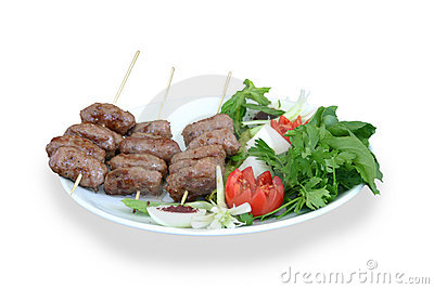 Portion of meatballs served with salad