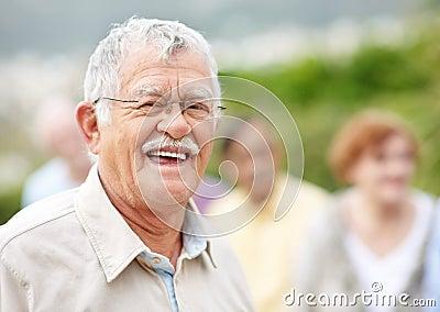 Portrait of active senior man smiling outdoors