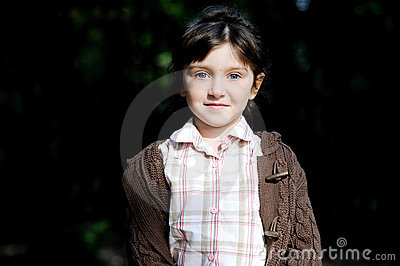 Portrait of adorable child girl in autumn forest