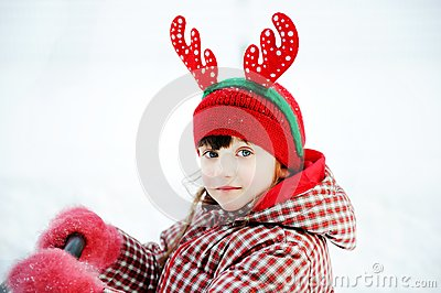 Portrait of adorable child girl in horned hat