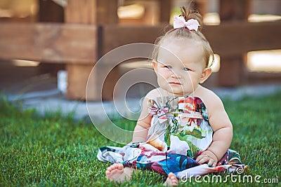 Portrait of adorable infant smiling girl in summer outdoor