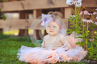 Portrait of adorable infant smiling girl in summer outdoor