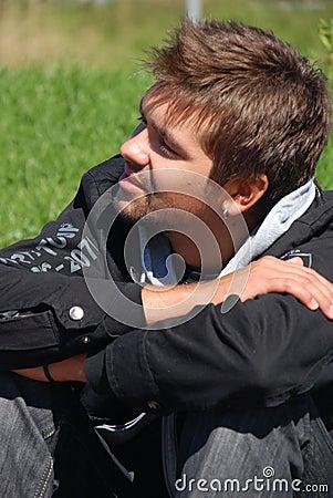 Portrait of adult guy in black windbreaker