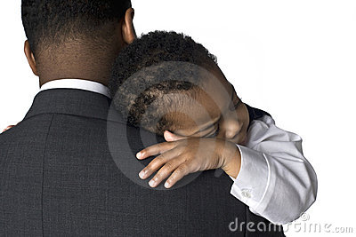 Portrait of an African American father holding his