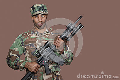 Us marine corps soldier holding m4 assault rifle over brown background - Portrait Of African American Us Marine Corps Soldier