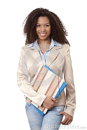 Portrait of afro woman with folders smiling