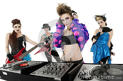 Portrait of all female punk rock band over white background