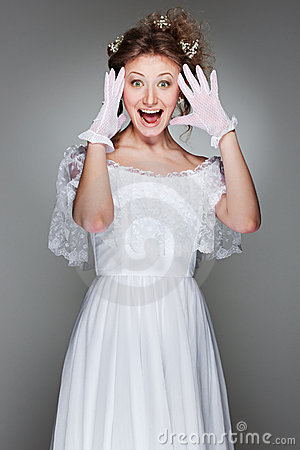 Portrait of amazed woman in white dress