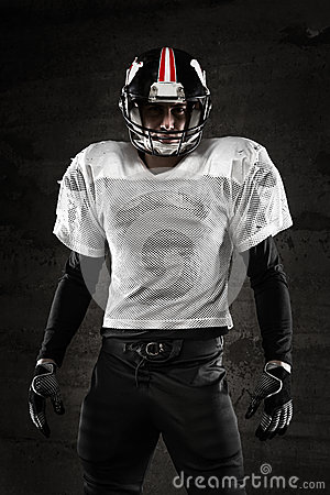 Portrait of american football player looking at camera