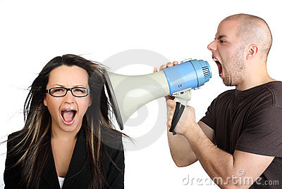 Portrait of angry man shouting at megaphone