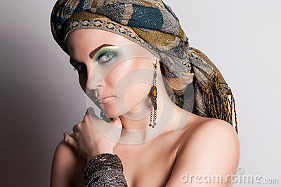Portrait of Arabic girl. Woman in a headscarf.