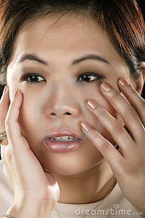 Portrait Of Asian Girl Holding Her Face