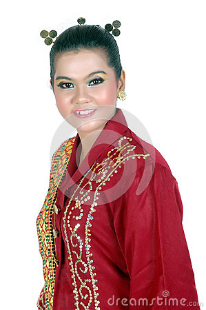 Portrait of an asian young girl dressed in traditional indigenous tribal borneo