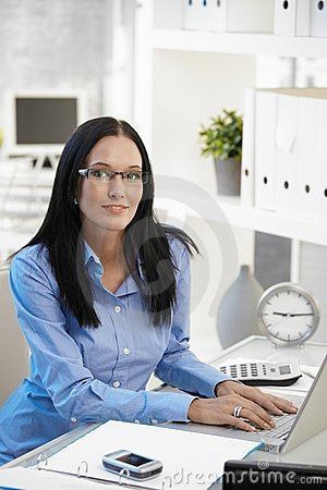 Portrait of assistant girl in office