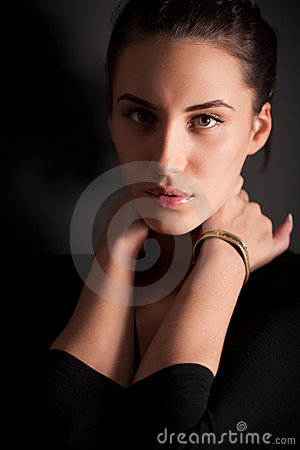 Portrait of attractive brunette girl over gray