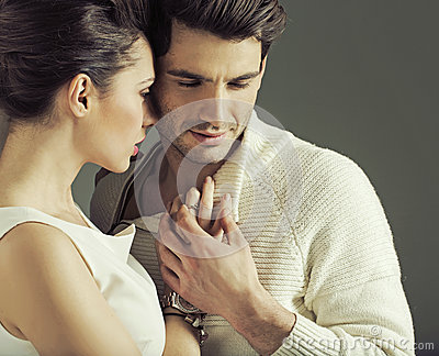 Portrait of attractive couple in love pose