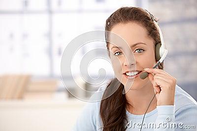 Portrait of attractive dispatcher with headphones