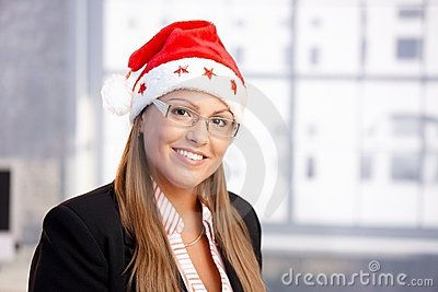 Portrait of attractive female in santa claus hat