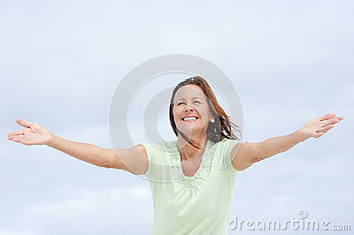 Positive mature woman open arms