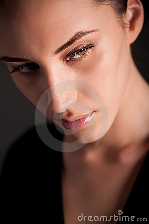Portrait of attractive melancholic brunette girl