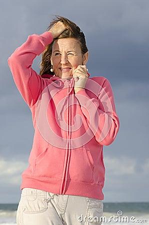 Portrait attractive senior woman at beach