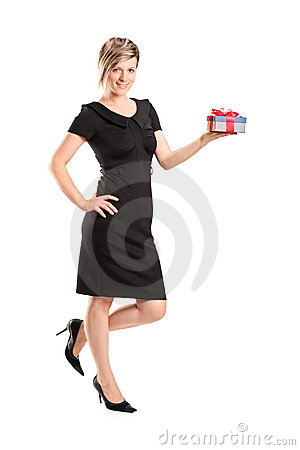 Portrait of an attractive woman holding a gift
