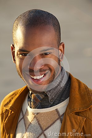 Portrait of an attractive young african american man smiling outdoors