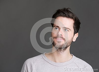 Portrait of an attractive young man with beard looking away