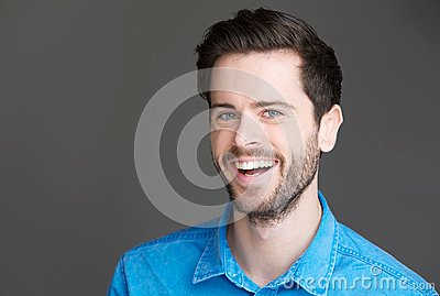 Portrait of an attractive young man laughing