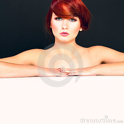 Portrait of attractive young red hair female model