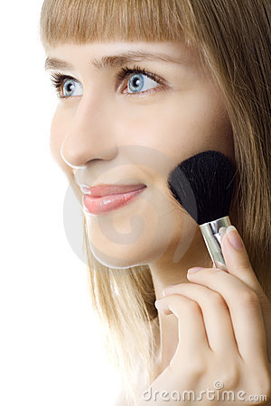 Portrait attractive young woman applying blusher