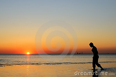 Portrait of bald woman as silhouette by the sea