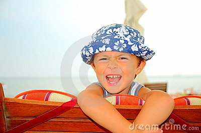 Portrait of a beach boy laughing