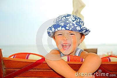 Portrait of a beach boy laughing