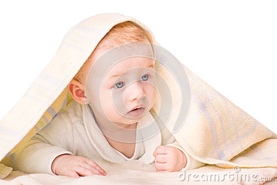 Portrait of a beautiful baby under a blanket