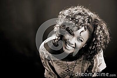 Beautiful black woman on black background. Studio shot